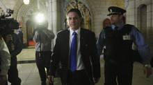 Senator Patrick Brazeau leaves the Senate chamber after it voted for him to take a leave of absence on Parliament Hill in Ottawa February 12, 2013. Brazeau was charged with charged with assault and sexual assault last week. (CHRIS WATTIE/REUTERS)