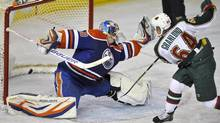 Minnesota Wild's Mikael Granlund (R) scores a goal against Edmonton Oilers' goalie Devan Dubnyk during the second period of their NHL game in Edmonton April 16, 2013. (DAN RIEDLHUBER/REUTERS)