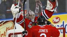 Portland Winterhawks' goalie Mac Carruth (L) celebrates with teammate Seth Jones after they defeated the London Knights to advance to the finals of the Memorial Cup Canadian Junior Hockey Championships in Saskatoon, Saskatchewan, May 24, 2013. (TODD KOROL/REUTERS)