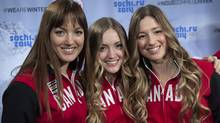 Sisters Maxime, Chloe and Justine Dufour-Lapointe, left to right, smile after being introduced as members of Canada's Olympic freestyle skiing team, Monday, January 20, 2014 in Montreal. (Paul Chiasson/THE CANADIAN PRESS)