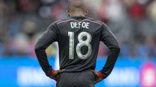 Toronto FC 's Jermain Defoe reacts to a missed goal scoring opportunity against D.C. United during first half MLS action in Toronto on Saturday March 22, 2014. (The Canadian Press)