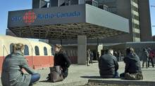 People sit outside CBC and Radio-Canada headquarters in Montreal on March 25, 2009. (Ryan Remiorz/The CANADIAN PRESS)