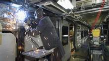 A welder works inside a commuter rail car in this file photo. On Thursday, Bombardier announced a major rail deal with the Stockholm transport authority. (JACQUES BOISSINOT/CP)