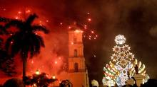 Fireworks light up the church during a Christmas celebration in the village of Remedios, Cuba, late Dec. 24, 2012. (Ismael Francisco/AP)