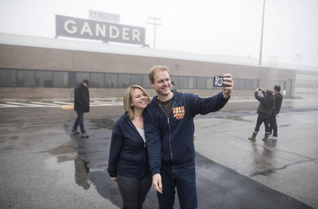 David Hein, left, and Irene Sankoff, the husband-and-wife writing team behind the musical Come From Away, hold take a selfie on the tarmac of the Gander International Airport in Gander, N.L