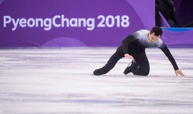 Canada's Patrick Chan falls during his short program in the men's portion of the figure skating team competition at the Pyeonchang Winter Olympics Friday, February 9, 2018 in Gangneung, South Korea.