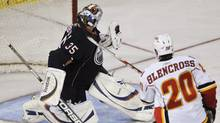 Calgary Flames' Curtis Glencross, right, scores a short-handed goal against Edmonton Oilers goalie Nikolai Khabibulin during the second period of their preseason NHL hockey game in Edmonton September 23, 2009. (DAN RIEDLHUBER)