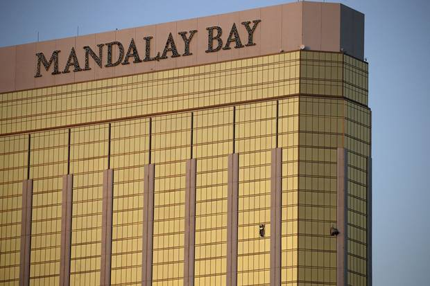 Drapes billow out of broken windows at the Mandalay Bay Resort and Casino on the morning after the shooting.