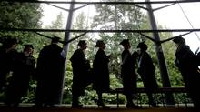 University of British Columbia students are silhouetted as they wait to enter a ceremony where they received their degrees during a fall convocation ceremony. (DARRYL DYCK FOR THE GLOBE AND MAIL)