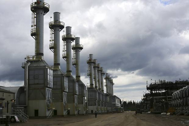 Rows of steam generating plants at Cenovus Energy's Christina Lake oil sands operation in Christina Lake, Alberta, Canada, June 12, 2013.