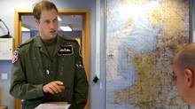 Prince William attends a briefing at RAF Valley on Anglesey, before a training exercise at nearby Holyhead Mountain in Wales. (HO/Ministry of Defence/Reuters)