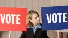 Politician holding Vote signs (Jupiterimages/Getty Images)