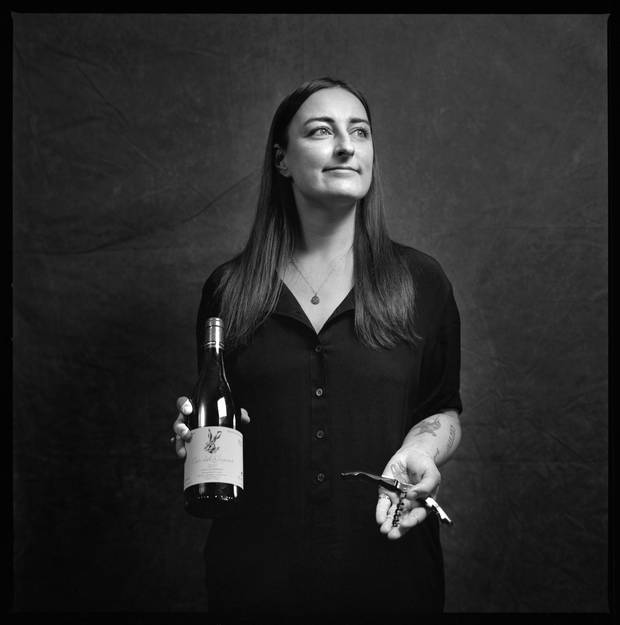 Lexi Wolkowski is photographed at Bar Raval with a bottle of 2013 Escoda-Sanahuja 'Nas del Gegant' from Conca de Barberà, Spain.