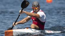 Canada's Adam van Koeverden celebrates after winning his K1 1000m heat at the 2009 ICF Canoe Sprint World Championships on Lake Banook in Dartmouth, N.S. on Friday Aug. 14, 2009. (Adrian Wyld)