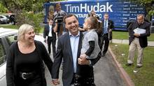 Ontario PC Leader Tim Hudak, centre, arrives for a photo-op with wife Deb Hutton, left, and their three-year-old daughter Miller in Scarborough, Ont., on Sept. 6, 2011. (Darren Calabrese/Darren Calabrese for The Globe and Mail)
