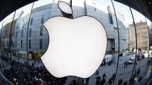 Apple reports earnings, Tuesday (MICHAELA REHLE/REUTERS)