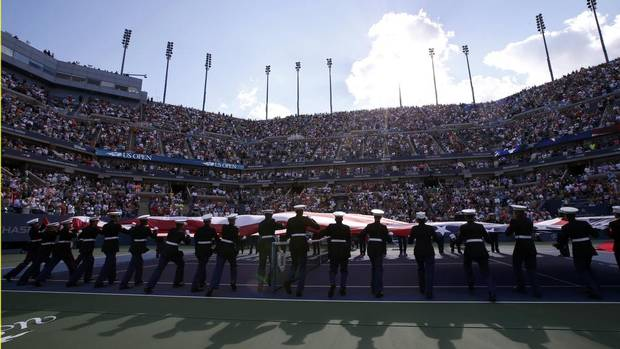 Members of the U.S. military unfurl a large American flag during ceremonies ahead of the women's singles final match between Serena Williams of the U.S. and Victoria Azarenka of Belarus at the U.S. Open tennis championships in New York September 8, 2013. (MIKE SEGAR/REUTERS)