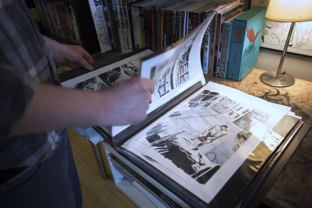 Lemire looks through artwork for Roughneck, in his Toronto studio.