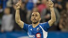Montreal Impact Marco Di Vaio celebrates his goal as they face the Houston Dynamo during first half MLS action Wednesday, June 19, 2013 in Montreal. (Paul Chiasson/THE CANADIAN PRESS)