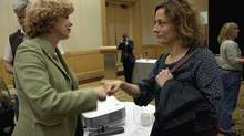 Singer songwriter Sarah Harmer, right, fist-bumps Chris Page of the Centre for Environmental Health following a news conference in Vancouver, Oct. 16, 2012. Page and Harmer are a part of a Nobel Women's Initiative Delegation to Alberta and British Columbia to bring attention to the Alberta oilsands and the construction of the Northern Gateway Pipeline. (JONATHAN HAYWARD/THE CANADIAN PRESS)