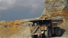 A truck waits for ore at Newmont Mining Corp's copper and gold mine on Indonesia's Sumbawa island, in this file picture taken September 21, 2012. (STAFF/REUTERS)