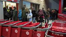 Shoppers enter the Target store in Dartmouth, N.S., on Black Friday. (ANDREW VAUGHAN/THE CANADIAN PRESS)