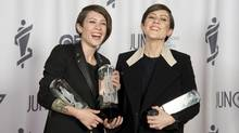 Tegan and Sara celebrate their three Juno Awards for Pop Album of the Year, Group of the Year and Single of the Year during the Junos in Winnipeg, Sunday, March 30, 2014. THE CANADIAN PRESS/Jonathan Hayward (JONATHAN HAYWARD/THE CANADIAN PRESS)