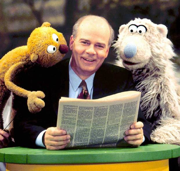 Peter Mansbridge with the puppets of Sesame Park, the Canadianized version of Sesame Street, in 1996.