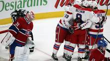 Montreal Canadiens goalie Carey Price (31) looks on as Washington Capitals Nicklas Backstrom (19) celebrates his goal with teammates during second period NHL action in Montreal, April 20, 2013. (CHRISTINNE MUSCHI/REUTERS)