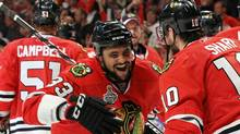 Patrick Sharp #10 and Dustin Byfuglien #33 of the Chicago Blackhawks celebrate after Byfuglien scored the game-winning gaol to defeat the Philadelphia Flyers 7-4 in Game Five of the 2010 NHL Stanley Cup Final at the United Center on June 6, 2010 in Chicago, Illinois. (Photo by Bruce Bennett/Getty Images) (Bruce Bennett/2010 Getty Images)
