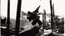 U.S. marine throwing grenade, Tet Offensive, Hue, South Vietnam, February 1968. Gelatin silver print. (Don McCullin/Contact Press Images)