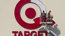 Workers install an outdoor sign at the new Target store at the Mic Mac Mall in Dartmouth, N.S. (ANDREW VAUGHAN/THE CANADIAN PRESS)