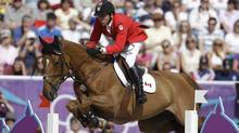 Eric Lamaze, of Canada, rides Derly Chin De Muze, during the equestrian show jumping team competition at the 2012 Summer Olympics, Monday, Aug. 6, 2012, in London. (Associated Press)