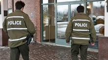 Quebec provincial police arrive at the Chateau Vaudreuil Suites Hotel outside Montreal, where it is believed Belhassen Trabelsi, the billionaire brother-in-law of Tunisia's deposed president Zine El Abidine Ben Ali, is staying on Jan. 27, 2011. (ROGERIO BARBOSA/AFP/Getty Images)