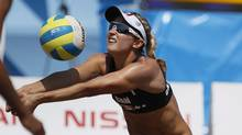 Canada's Heather Bansley sets the ball in a women's beach volleyball quarterfinal match against Brazil at the Pan American Games in Puerto Vallarta, Mexico, Wednesday Oct. 19, 2011. Brazil won 2-0. (Ariana Cubillos/AP/Ariana Cubillos/AP)