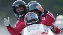 From front to back, Canada's Chris Spring, Timothy Randall, Adam Rosenke and Ben Coakwell celebrate after racing to a third-place finish during the four-man bobsled World Cup event in Whistler, B.C., on Saturday November 24, 2012. (DARRYL DYCK/THE CANADIAN PRESS)