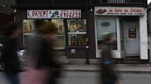 A group of pedestrians walk pass two ethnic restaurants in Gatineau, Quebec. (Dave Chan/The Globe and Mail/Dave Chan/The Globe and Mail)