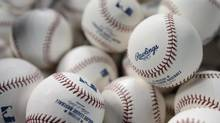 A basket of Rawlings baseballs await batting practice on April 1 2013 (Fred Lum/The Globe and Mail)