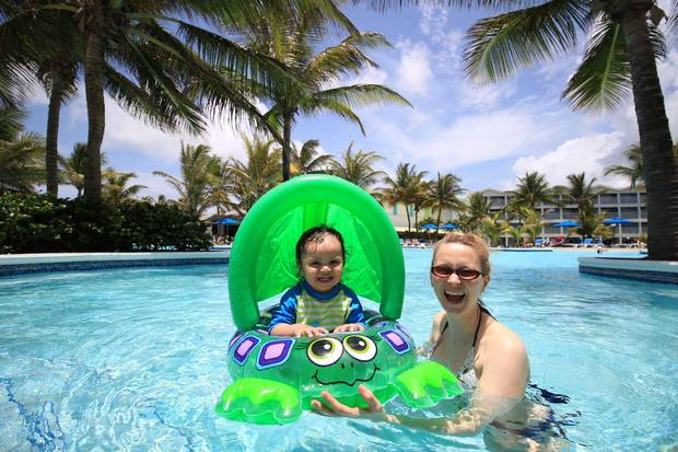 The author and her daughter, Alexandra, having a swim at Coconut Bay Beach Resort & Spa in Saint Lucia.