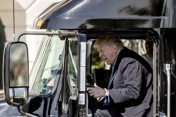 March 23, 2017: Mr. Trump pretends to drive as he gets in an 18-wheeler on the South Lawn of the White House as he meets with truckers and CEOs regarding health care.