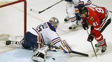 Chicago Blackhawks' Marian Hossa scores the game winning goal on Edmonton Oilers' Nikolai Khabibulin during the overtime of their NHL hockey game in Chicago, Illinois, February 25, 2013. (JIM YOUNG/REUTERS)