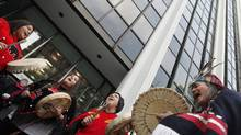 Native protestors demonstrate against the proposed Northern Gateway pipeline at Enbridge headquarters in Vancouver. (Simon Hayter For The Globe and Mail)