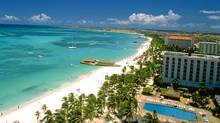 Enjoy a sunny holiday at Palm Beach in Aruba. (AP)