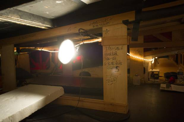 The crawl space under the stage where supers will position themselves before performing the fire hands scene.