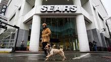 A woman walks her dog past the Sears store in downtown Vancouver, B.C., on Friday March 2, 2012. (DARRYL DYCK/DARRYL DYCK/THE CANADIAN PRESS)