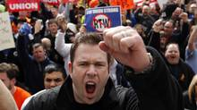 Rob Parsons, a steelworker from Merrillville, Ind., shouts during a union workers protest after the Senate voted to pass the right-to-work bill in Indianapolis, Wednesday, Feb. 1, 2012. (Michael Conroy)