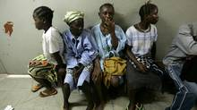Women sit in the Vesico Vaginal Fistula Ward of a hospital in Freetown, Sierra Leone. (The Globe and Mail/Deborah Baic)