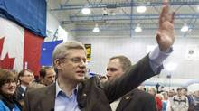 Conservative Leader Stephen Harper leaves a campaign rally in Beaumont, Alta., on March 28, 2011. (Adrian Wyld/The Canadian Press/Adrian Wyld/The Canadian Press)