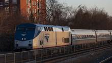 A New York to Toronto bound Amtrak train passes through the Oakville GO Station. (Philip Cheung For The Globe and Mail)