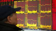 A trader looks at an electronic board of the Shanghai Stock Exchange at a brokerage in Beijing. It's widely accepted that China's GDP growth has slowed to 7 to 8 per cent a year, but few if any economists are calling for a serious decline - yet China is exhibiting all the telltale signs of a country that's hitting the wall. (STRINGER/REUTERS)